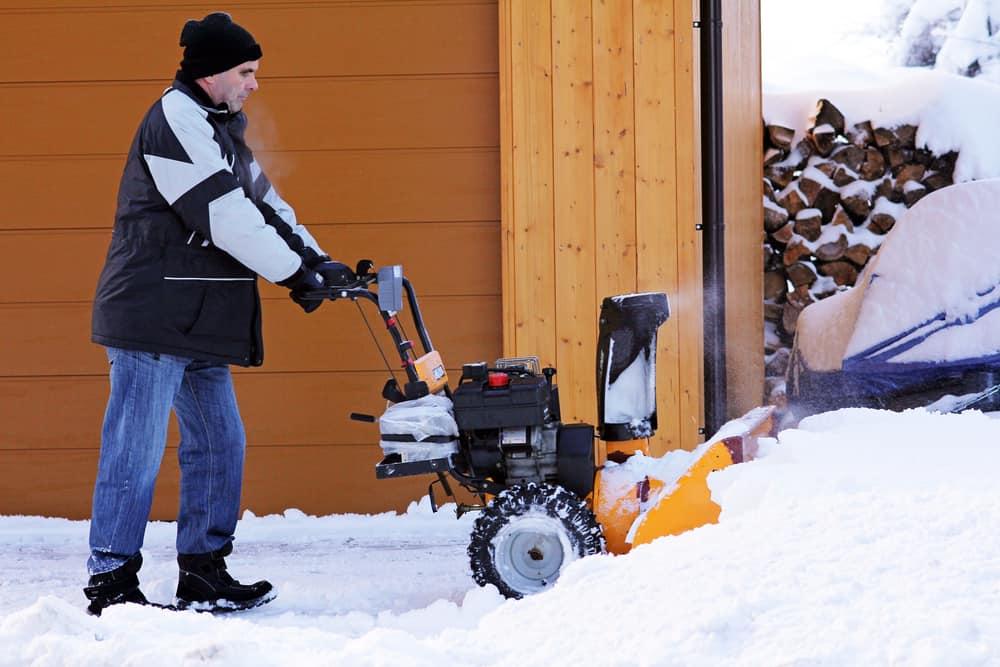Man pushing snowblower